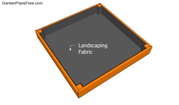 Fitting the fabric inside the sandbox